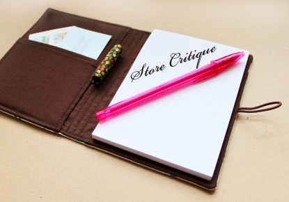 Open Notebook with a pen