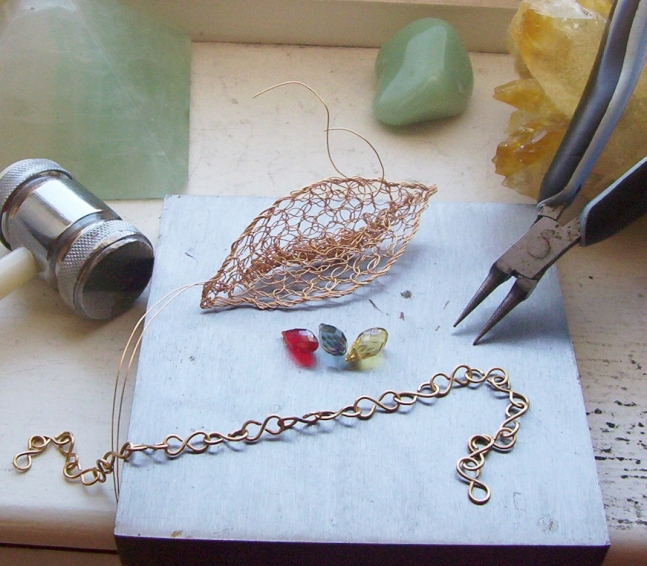 Wire and some gorgeous tiny briolettes in cherry, citrine and blue quartz.