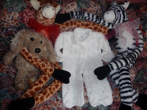 White Hand-Knitted Jumpsuit for a Newborn Baby