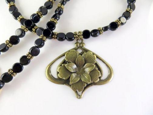 Black beaded necklace with gold pendant