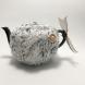 Beige teapot cozy