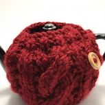 Red teapot cozy