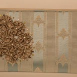 Front of purse decorated with taupe rosettes