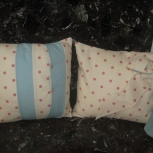Set of cream and pink polka dot cushions.