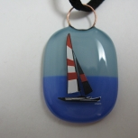 Sailboat on two-tone blue art glass