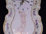 Hand Painted Porcelain Wall clock with Kewpie and Violets Decor