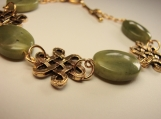 Olive jade with celtick conectors gold plated bracelet