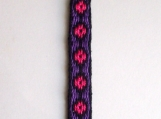 Black with hot pink dots on purple keychain