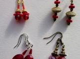 4 pairs of red earrings