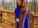 Long cowl in bright bold colors of merino wool and nylon blend.
