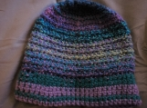Multi-colored purple and teal green crocheted hat