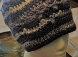 Purple and white crocheted hat