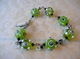 GREEN WITH ENVY-- Wire wrapped funky green square lampwork beaded bracelet.