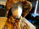 A brown and white Hat and scarf set