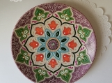 Handmade ceramic plate with a floral Mandala