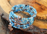 Blue Beaded Memory Wire Bracelet With Copper Flowers