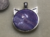 Whimsical cat shaped purple pendant with silver accents