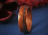 Wood ring made of Tigerwood with Lapis Lazuli stone inlay