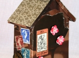 Tiny house chocolate, fine chocolate, found object art, with a bird