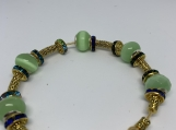 gold plated bracelet with green crystal