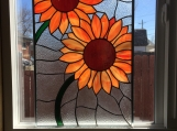 Stained glass sunflower panel, orange, red, yellow, green
