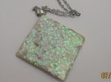 faux opal diamond shaped pendant with irredescient colors