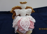 Crocheted pink pineapple angel