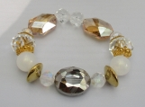 Irredescent golds and crystalL beaded stretch bracelet