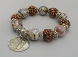 handbeaded brown bead stretch bracelet with a coin  dangle
