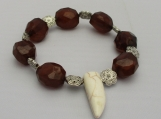 Shades of brown  beaded stretch bracelet with a ivory color sharks tooth bead dangle