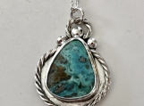 Turquoise Silver Pendant with Rope Embellishment