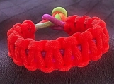 Paracord bracelet neon orange and rainbow