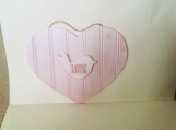 Pink wooden heart with bird