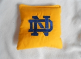 Gold Fabric  with blue lettering  N D Embroidered Corn hole Bags