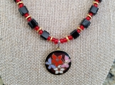 Black and red beaded necklace with cloisonne pendant