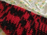 Black and red crochet scarf