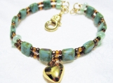 Green Czech beads with heart charm memory wire bracelet