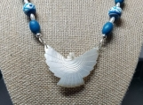 Carved Mother of Pearl Bird pendant necklace