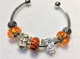 Orange Dolls bracelet