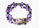 Purple Glass Beads and Striking Metal Flower and Crystal Center
