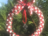 Christmas wreath ornament with cross charm