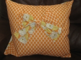 Retro orange and white polka dot cushion using designer, 'Amy Butler' fabric