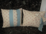 Stunning cream and pink polka dot cushion with blue trim