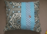 Stunning cushion in floral and polka dot design.