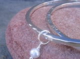 Inscribed 'Charmed' Bangle . Add a poem, quote, phrase, names on one side .  your choice of stone charm