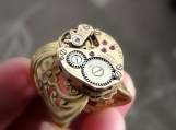 Steampunk wide brass filigree watch movement band ring
