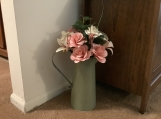 Large metal pitcher with paper flowers