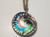Shimmering swirls of color circular glass pendant