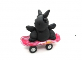 Black dragon on a skateboard