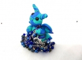 Blue and purple dragon with girls bracelet